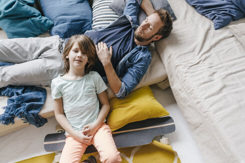 Father and son with skateboard relaxing at home - KNSF03615