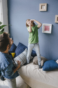 Playful father and son at home - KNSF03624
