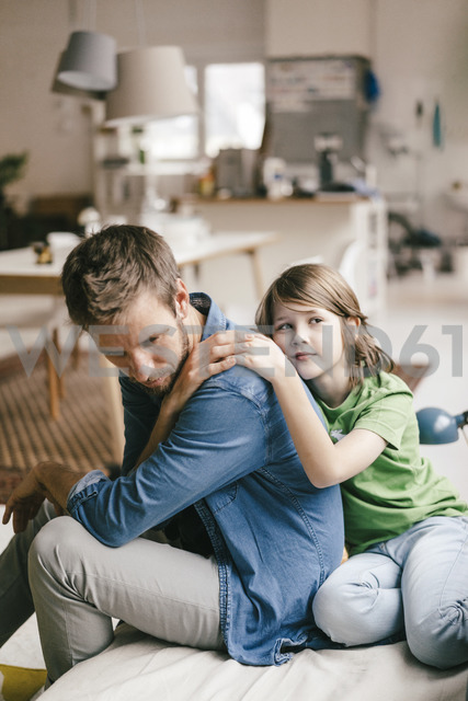 Son consoling sad father at home - KNSF03639