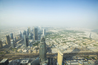 Aerial view of cityscape against sky during foggy weather from Burj Khalifa - CAVF28086