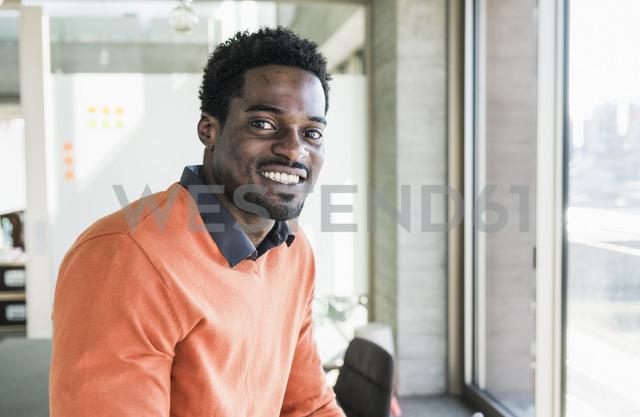 Portrait of smiling casual businessman - UUF13116