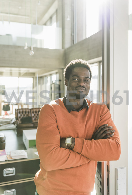 Portrait of confident casual businessman in office - UUF13152