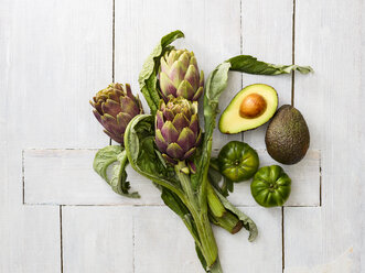 Artichokes, green tomatoes, and sliced and whole avocado - KSWF01840