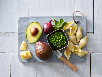 Ingredients of pasta with avocado sauce, peas and parmesan - KSWF01846