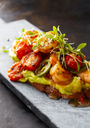 Crostini with shrimps and tomato, roasted bread, herbs, avocado cream, sweet chili sauce, jalapenos, cress - KSWF01864