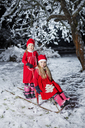 Sisters wearing red dresses with sled - FOLF00045
