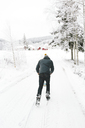 Man walking along road covered with snow - FOLF00114