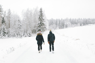 Young couple walking along road covered with snow - FOLF00120