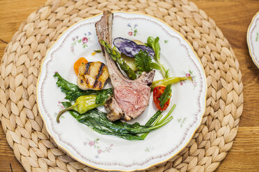 Lamb and vegetables on plate - KVF00128
