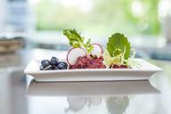 Garnished salad on plate - KVF00131