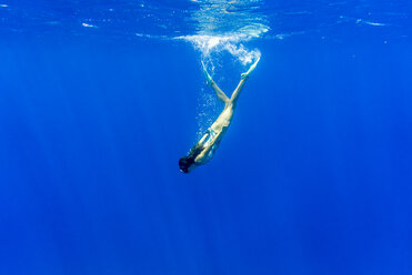 Young woman swimming underwater in sea - CAVF28410