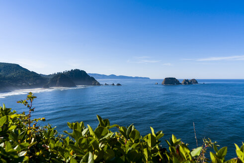Scenic view of cannon beach against blue sky - CAVF28443
