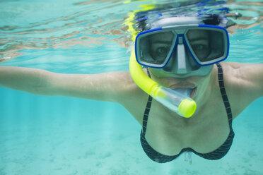 Portrait of woman snorkeling under water - ZEF15240