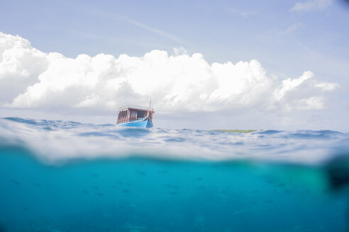 Maldives, split shot of boat on water - ZEF15249