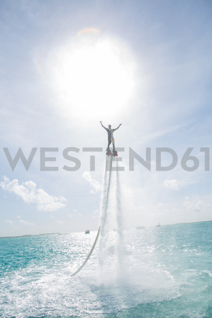 Maldives, man on flyboard above the sea - ZEF15252