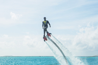 Maldives, man on flyboard above the sea - ZEF15255