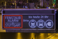 Germany, Stuttgart, Warning sign for particulate pollution on street - WDF04489
