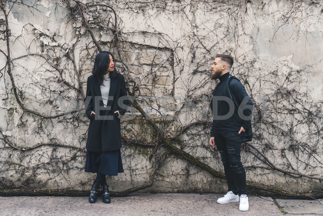 Young couple standing in front of wall - AFVF00361