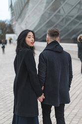 France, Paris, portrait of young woman hand in hand with her boyfriend - AFVF00364