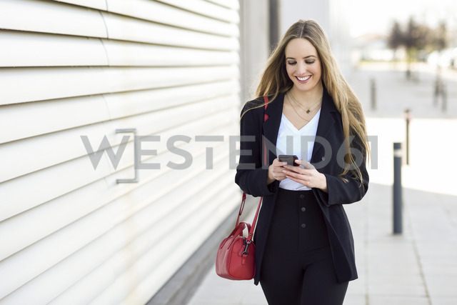 Portrait of content businesswoman using cell phone - JSMF00128