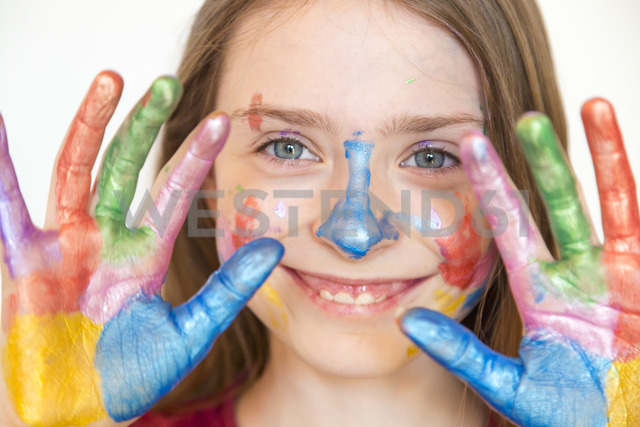 Portrait of smiling girl with finger paints on hands - SARF03618