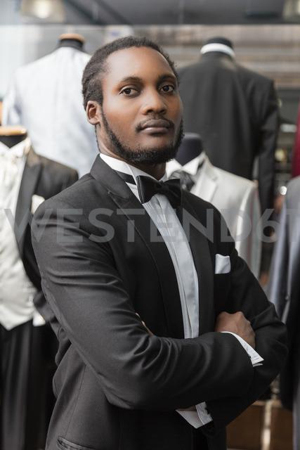 Portrait of a man wearing tuxedo in tailor shop - LFEF00126