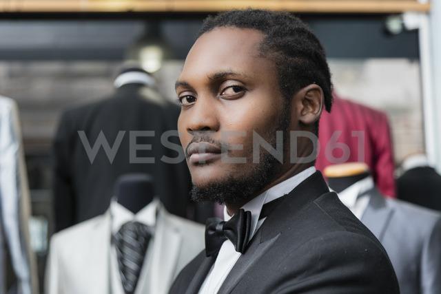 Portrait of a man wearing tuxedo in tailor shop - LFEF00129
