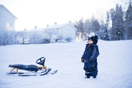 Young boy standing on snow - FOLF00712