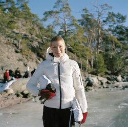 Portrait of mid adult woman holding ice skates - FOLF00799