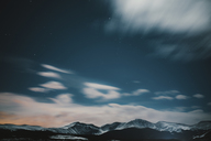 Idyllic view of snowcapped mountains against cloudy sky - CAVF28633