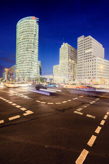 Road intersection and illuminated skyscrapers at night - FOLF00926