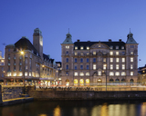 Illuminated buildings with river in foreground at dusk - FOLF01061
