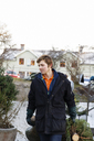 Young man working in christmas tree lot - FOLF01097