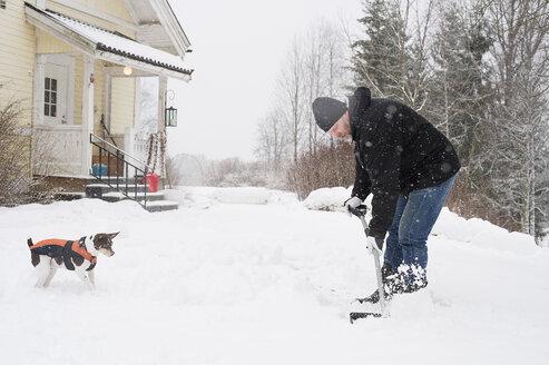 Mature man clearing snow - FOLF01166