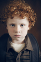 Close-up portrait of serious boy with backpack - CAVF29188