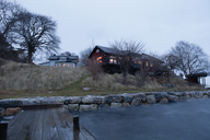 House on hill next to water - FOLF01733