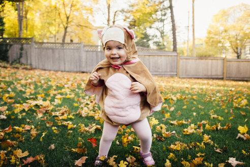 Portrait of happy baby girl wearing bird costume at park - CAVF29861