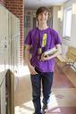 Teenage boy walking on school corridor - FOLF02130