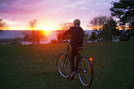 Boy cycling at sunset - FOLF02181
