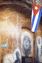 Cuban flag hanging from building with painting on wall - CAVF29930