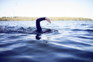 Cropped image of woman swimming in lake - CAVF29966