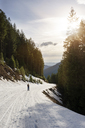 Mid distance of man standing on snow covered footpath on mountain at Gifford Pinchot National Forest - CAVF30161