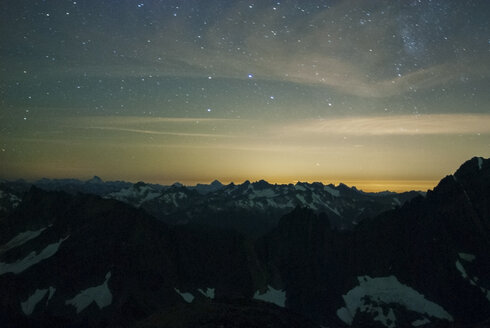 Scenic view of snowcapped mountains against sky during night - CAVF30305