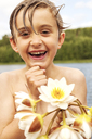 Portrait of boy holding flowers - FOLF02340