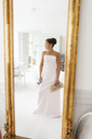Reflection of young bride in mirror - FOLF02502