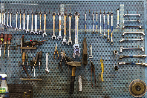 Tools hanging against wall in workshop - FOLF03201