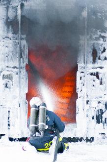 Firefighter spraying foam to stop fire - FOLF03450