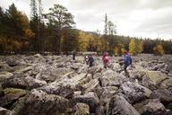 Hikers walking on rocks against sky - CAVF31081
