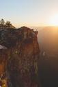Man standing at edge of rock in Yosemite National Park - FOLF03634