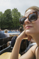 Young woman in Berlin during tourboat travel - FOLF03670